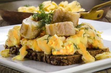 Whole grain bread, scrambled eggs and eel.