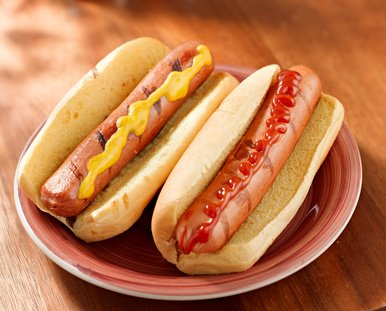 Hot dogs and mustard and ketchup.