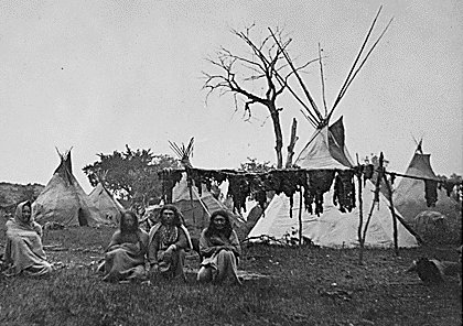 Native americans drying strips of meat.