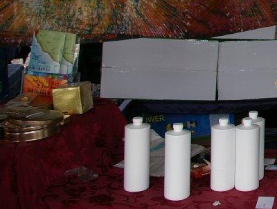 Noni juice in white bottles.