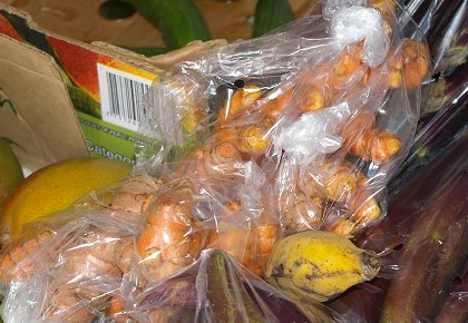 A bag of turmeric root in a Hilo farmers market.
